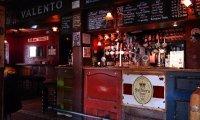 Enjoy the ambiance of a lively corner pub.
