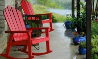 Sitting on a front porch in the country during a thunderstorm.