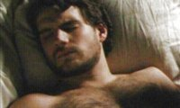 Sleeping next to Henry Cavill