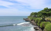 Sit by the Temple dock in Bali