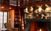 Sitting in a cozy library next to a fireplace