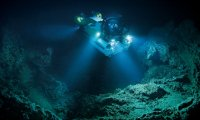 Drinking a stolen can of soda at the bottom of Mariana Trench