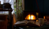Cuddling by a fire on a snowy night