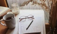 Writing on a typewriter while you sip tea and listen to the rain outside
