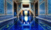 An quiet, echoing, indoor pool.